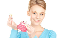 Lovely woman with purse and money Royalty Free Stock Photos