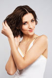 Lovely woman put her wet hair. Beautiful woman put her wet hair Royalty Free Stock Images