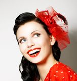 Vitality. Cheerful Young Woman with Red Bow enjoying. Pleasure. Lovely Woman with Red Bow enjoying. Pleasure Royalty Free Stock Photo