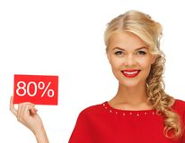 Lovely woman in red dress with discount card Royalty Free Stock Photo
