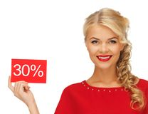 Lovely woman in red dress with discount card Stock Photos