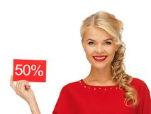 Lovely woman in red dress with discount card Royalty Free Stock Photos