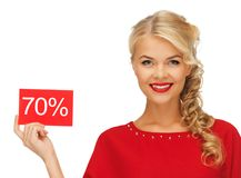 Lovely woman in red dress with discount card Stock Image