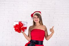 Lovely woman in red dress with heap of xmas presents. Stock Images