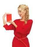 Lovely woman in red dress with note card Royalty Free Stock Image