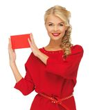 Lovely woman in red dress with note card Stock Images