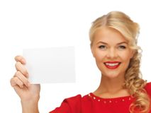 Lovely woman in red dress with note card Royalty Free Stock Photos