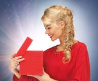 Lovely woman in red dress with opened gift box Stock Photo