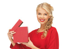 Lovely woman in red dress with opened gift box Royalty Free Stock Photography