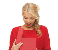 Lovely woman in red dress with opened gift box Royalty Free Stock Images