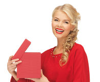 Lovely woman in red dress with opened gift box Stock Images