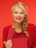 Lovely woman in red dress with opened gift box Stock Image