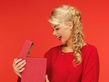 Lovely woman in red dress with opened gift box Stock Photos