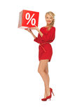 Lovely woman in red dress with percent sign Royalty Free Stock Photography