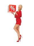 Lovely woman in red dress with percent sign Stock Photography