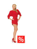 Lovely woman in red dress with percent sign Royalty Free Stock Photos