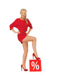 Lovely woman in red dress with percent sign Stock Images