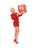 Lovely woman in red dress with percent sign Stock Photo