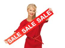 Lovely woman in red dress with sale sign Stock Photos