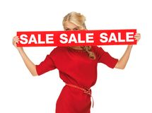 Lovely woman in red dress with sale sign Royalty Free Stock Photo