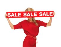 Lovely woman in red dress with sale sign Royalty Free Stock Images