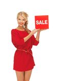 Lovely woman in red dress with sale sign Stock Images