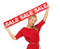 Lovely woman in red dress with sale sign Stock Image