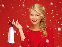 Lovely woman in red dress with shopping bag Stock Images