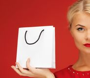 Lovely woman in red dress with shopping bag Royalty Free Stock Photo