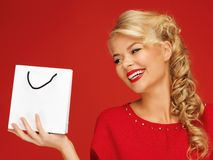 Lovely woman in red dress with shopping bag Stock Photo