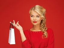 Lovely woman in red dress with shopping bag Royalty Free Stock Images