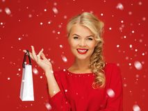 Lovely woman in red dress with shopping bag Royalty Free Stock Photos