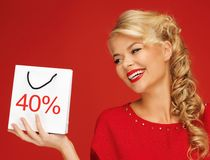 Lovely woman in red dress with shopping bag Stock Image
