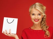 Lovely woman in red dress with shopping bag Royalty Free Stock Photography