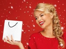 Lovely woman in red dress with shopping bag Stock Photography