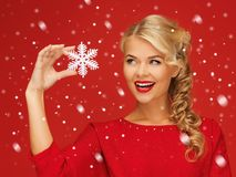 Lovely woman in red dress with snowflake Stock Photo