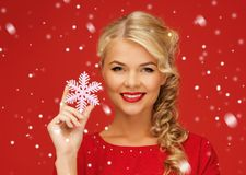 Lovely woman in red dress with snowflake Royalty Free Stock Photo