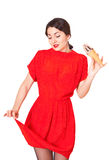 Lovely woman in a red dress soiled ice cream Royalty Free Stock Photo