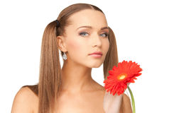 Lovely woman with red flower Stock Images