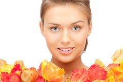 Lovely woman with red flowers Stock Photography