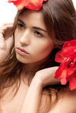 Lovely woman with red flowers Stock Photo