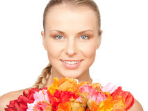 Lovely woman with red flowers Royalty Free Stock Photos