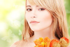 Lovely woman with red flowers and butterflies Stock Photography