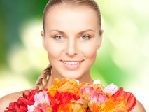 Lovely woman with red flowers Royalty Free Stock Photography