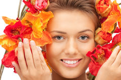 Lovely woman with red flowers Royalty Free Stock Image