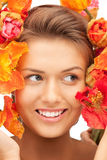 Lovely woman with red flowers Royalty Free Stock Photo