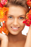 Lovely woman with red flowers Royalty Free Stock Images