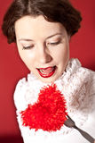 Lovely woman with red hear Stock Image