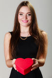 Lovely woman with red heart shaped gift box Stock Images