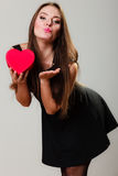 Lovely woman with red heart shaped gift box Stock Photos